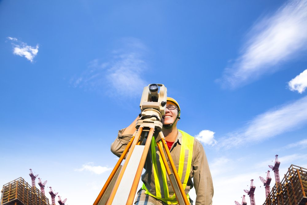 surveyor with surveying equipment