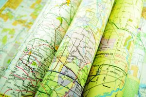 Various colourful road maps folded